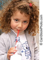 little girl drinking mineral water