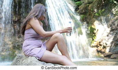 drinking water near the waterfall