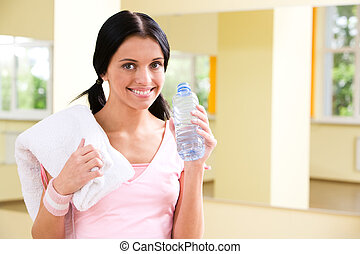 Drinking water - Portrait of sporty girl holding bottle with...