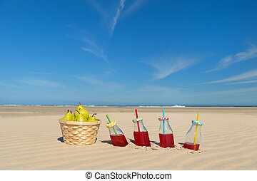 Drinks and fruit at the beach