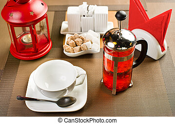 drinks - glass teapot with cranberries tea, on table in...