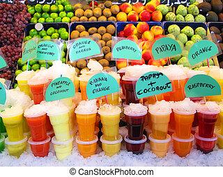 Drinks - Colorful fruit juices in La Boqueria (Barcelona...