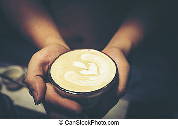 Drip coffee latte art, vintage filter image