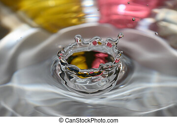 A water drip crown with a pink and yellow background