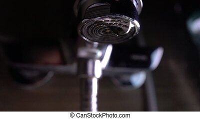 Dripping faucet. Leakage concept. Super slow motion macro shot