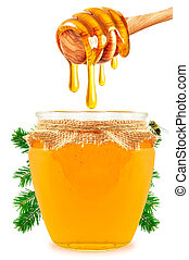 honey in a jar - dripping honey in a jar isolated on white...