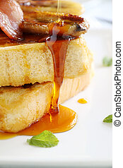 Dripping Maple Syrup - Maple syrup dripping down caramelized...