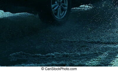 drive cars through puddles movement of traffic and snow...