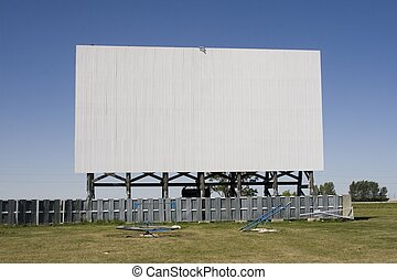 Drive-In Movie Scree - A vintage drive-in movie screen,...