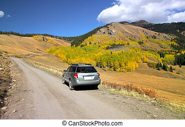 Off road driving in Rocky mountains in Colorado in autumn time