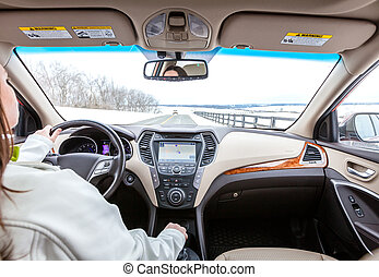 Drive - Woman is driving a car. Interior view from the...