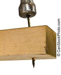 Drive the Nail - Close up shot of a hammer driving a nail...