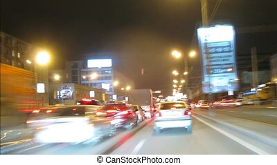Drive through Moscow at night, view from car