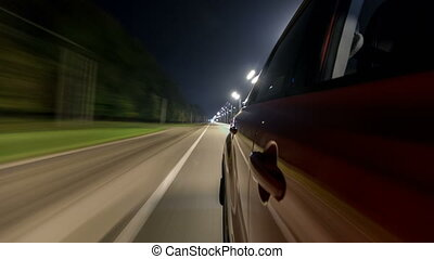 Drivelapse from Side of Car moving on a night highway...