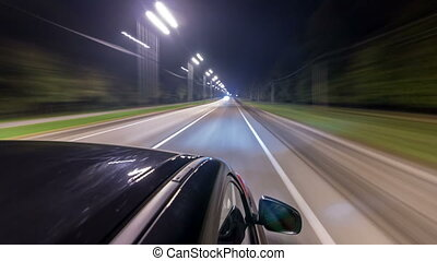 Drivelapse from top Side of Car moving on a night highway...