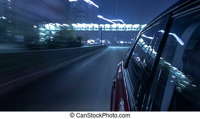Drivelapse urban look from fast driving car at a night...