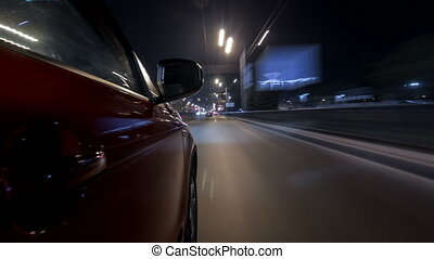 Drivelapse urban look from fast driving car at a night avenue in a city timelapse hyperlapse