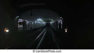 Driveless underground train coming to the station