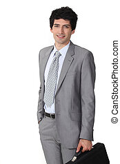 Driven young businessman with briefcase