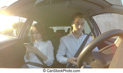 Driver and girlfriend use smart phones and texting while...