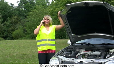 Driver calling breakdown service - Young femle driver...