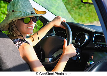 driver driving in hat  a car on the road