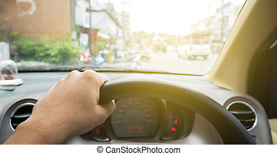 Driver eye view with hand on wheel in vintage style