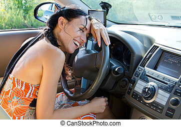 Driver leaning on car steering wheel