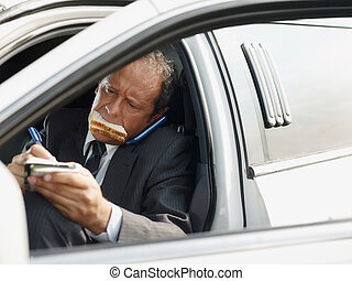 Driver Of White Limousine Eating Lunch Inside Car