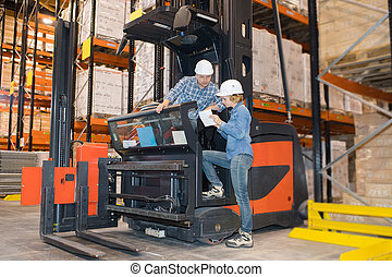 driver on forklift truck transporting from packaging machine to warehouse