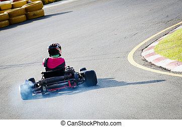 Driver on kart circuit - Karting - driver in helmet rushes...