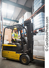 Driver operating forklift machine