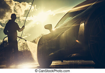 Driver Power Washing His Performance Car During Sunset