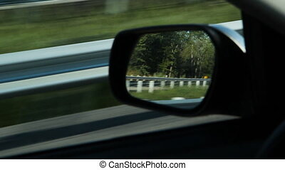 Driver side mirror. Stop action. - Reflections in driver...