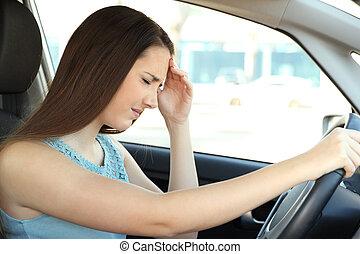 Driver suffering migraine driving a car