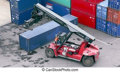 Driver takes seat in crane cabin and drives backward among...