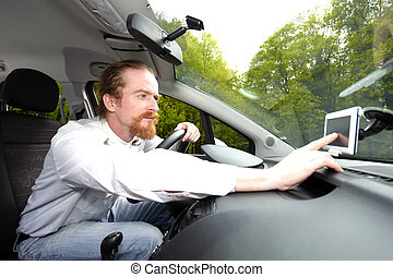 Driver using  GPS navigation a way