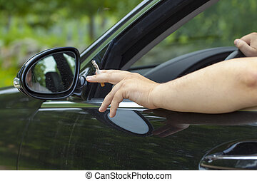 Driver with a cigarette in hand