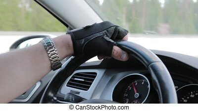 drivers hands on the steering wheel