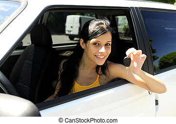 driver's license passed: teenage girl driving her new car