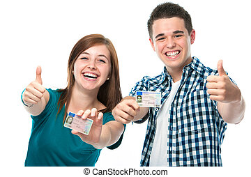drivers license - happy teens showing their driving license