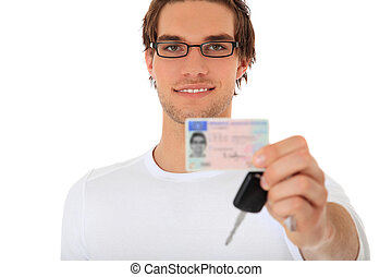 Driver?s license - Young guy showing his drivers license and...