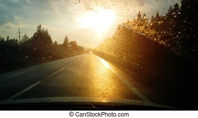 Driver's Perspective of Rain and Sunset on the Highway....