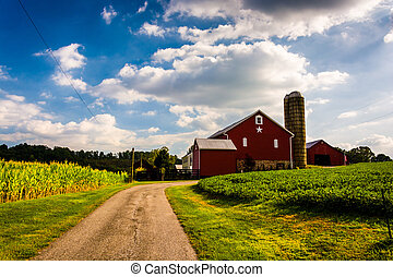 Driveway and red barn in rural York County, Pennsylvania. -...