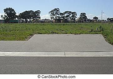 Driveway to land lot