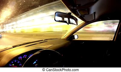 Driving a car at night in the city.