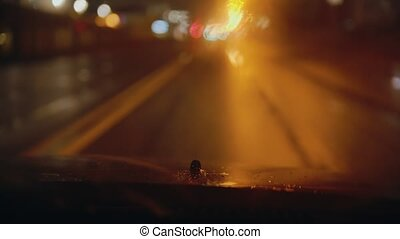 Driving a car at wet rainy night - splash onto the ...