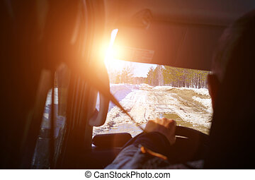 Driving a car in the first person. driving on a winter ice road. selective focus