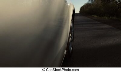 Driving a car is a country road. Wheel spinning POV - Point...
