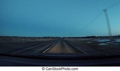 driving a car on a country road at night